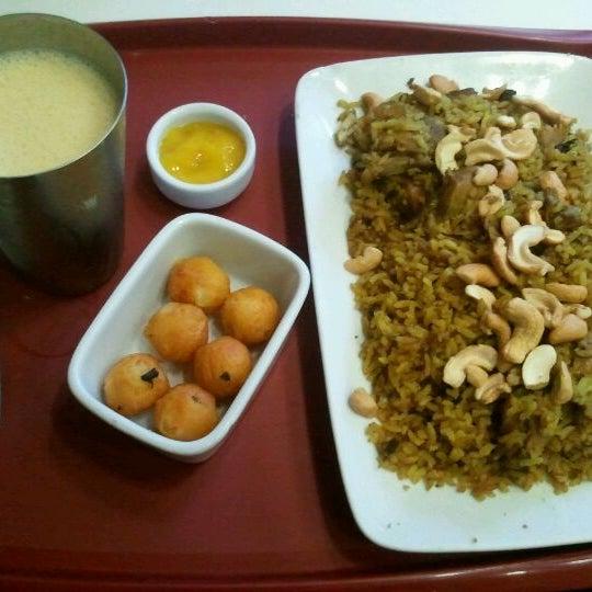 Photo taken at Madhu by Erika S. on 6/2/2012