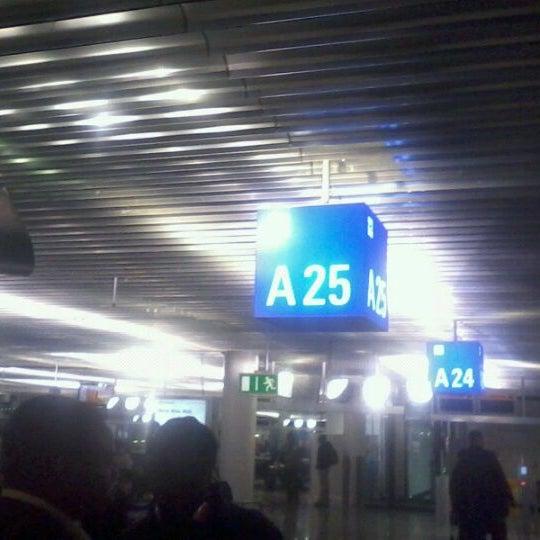 Photo taken at Gate A25 by Momo A. on 1/3/2012