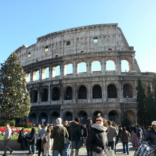 Photo taken at Piazza del Colosseo by Soomin K. on 12/28/2012