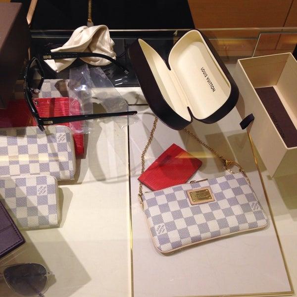 Photo taken at Louis Vuitton by Gavin D. on 8/14/2014