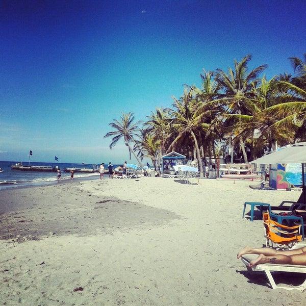 Photo taken at Playa El Yaque by Aliana P. on 5/1/2013