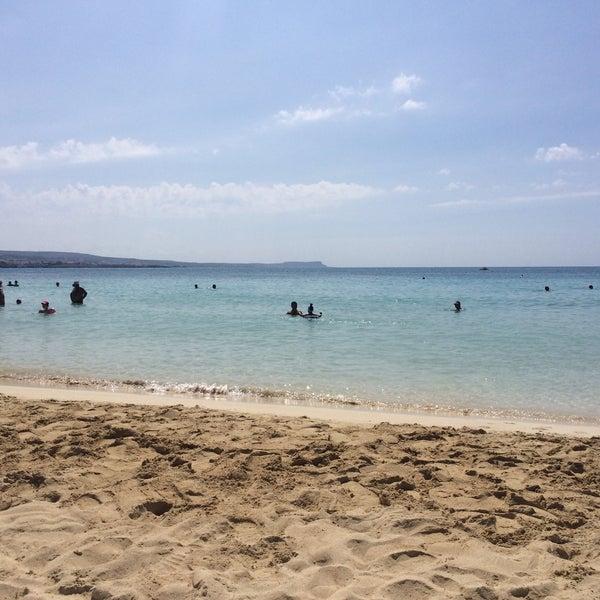Photo taken at Makronissos Beach by Elena G. on 6/21/2017