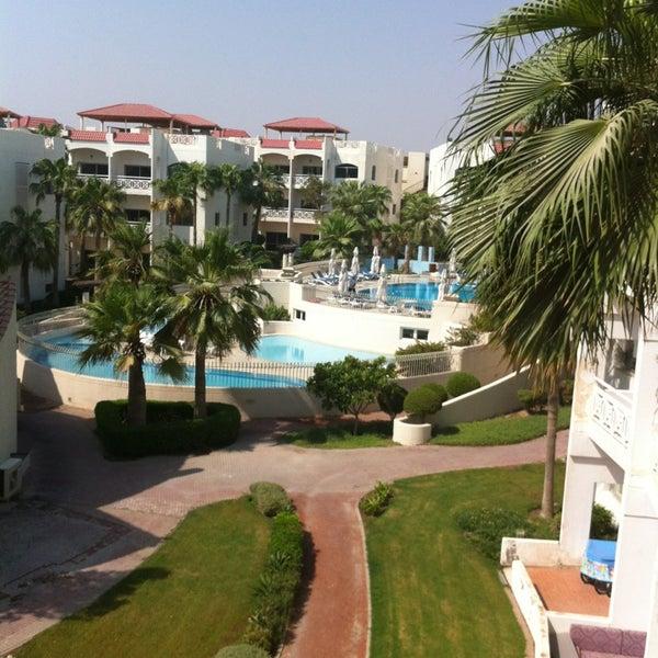 Photo taken at Rimal Hotel & Resort by Nawaf A. on 8/24/2014