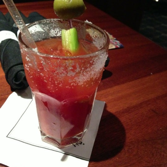 Photo taken at The Lion & Rose British Restaurant & Pub by Christina S. on 12/17/2012