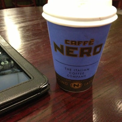 Photo taken at Caffè Nero by KT on 12/20/2012