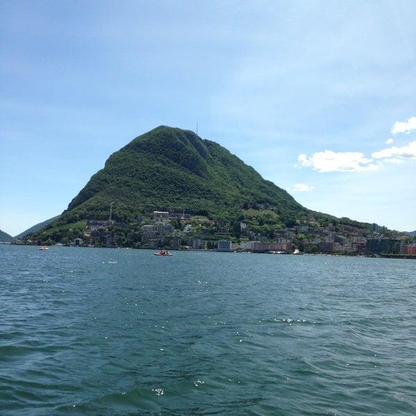 Photo taken at Lago di Lugano by Cristina S. on 6/25/2013
