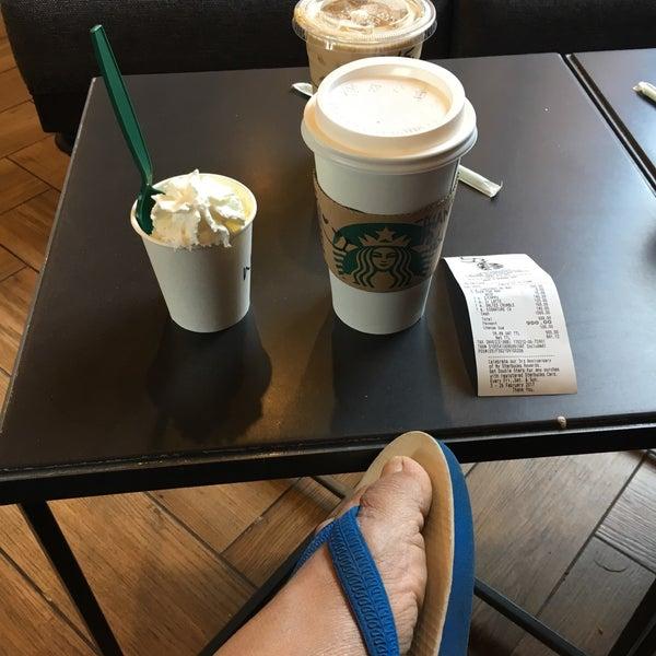 Photo taken at Starbucks by Kittisak T. on 2/12/2017