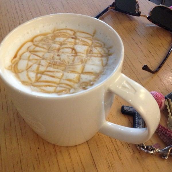 Photo taken at Starbucks by Lynne B. on 3/27/2014