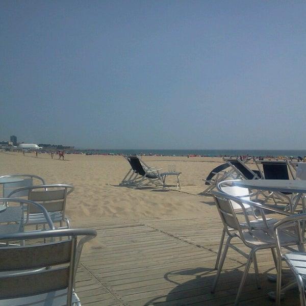 Photo taken at Praia do Titan by Edouard B. on 6/27/2013
