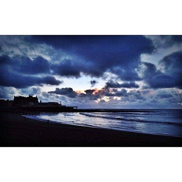 Photo taken at Aberystwyth Beach by Ali C. on 1/5/2014