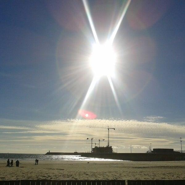 Photo taken at Praia do Titan by Filipe A. on 3/20/2013