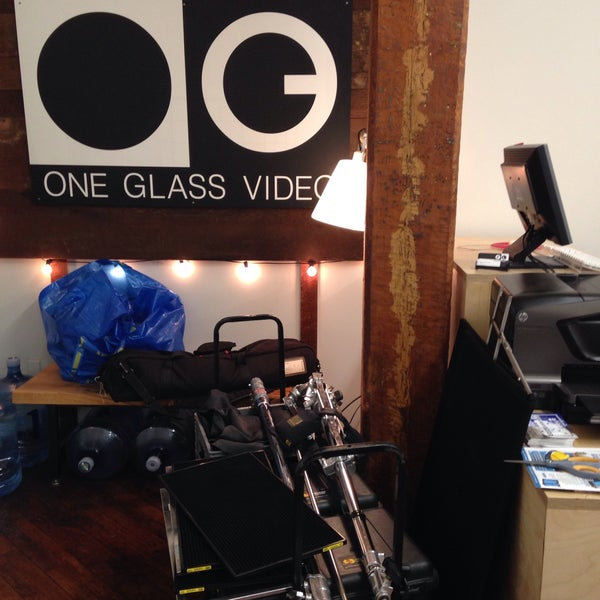 Photo taken at One Glass Video by Jessica L. on 3/2/2018