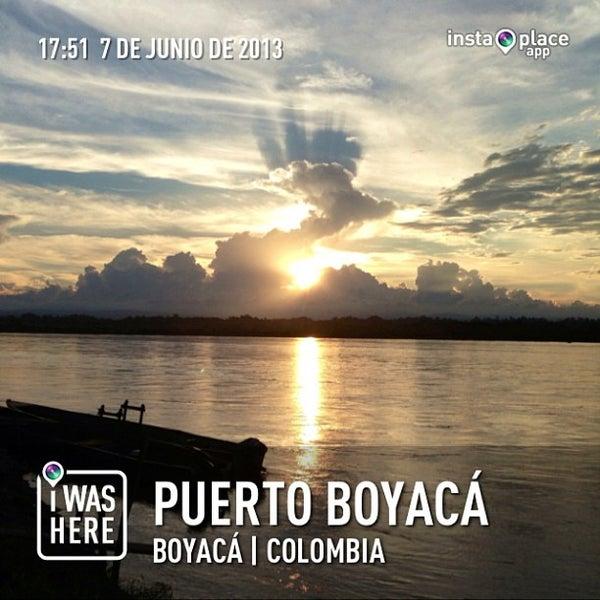 Photo taken at Puerto Boyaca by Diego J. on 6/8/2013