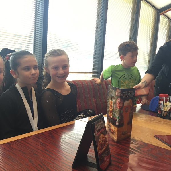 Photo taken at Red Robin Gourmet Burgers by About T. on 3/14/2015