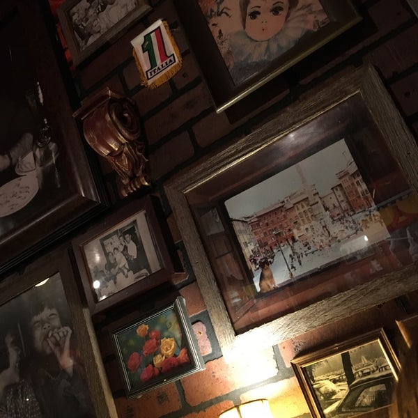 Photo taken at Buca di Beppo by Camila G. on 1/3/2017