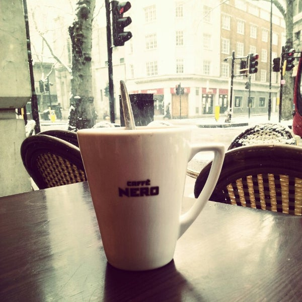 Photo taken at Caffè Nero by Adrien A. on 1/20/2013