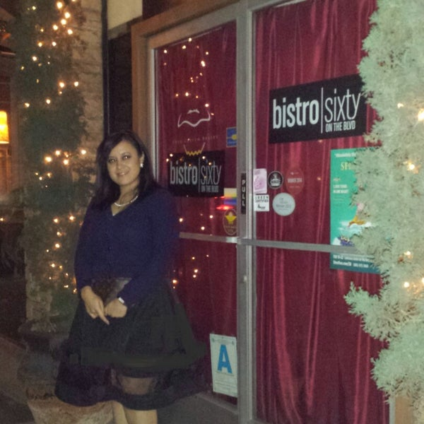 Photo taken at Bistro Sixty by Michelle K. on 12/26/2014