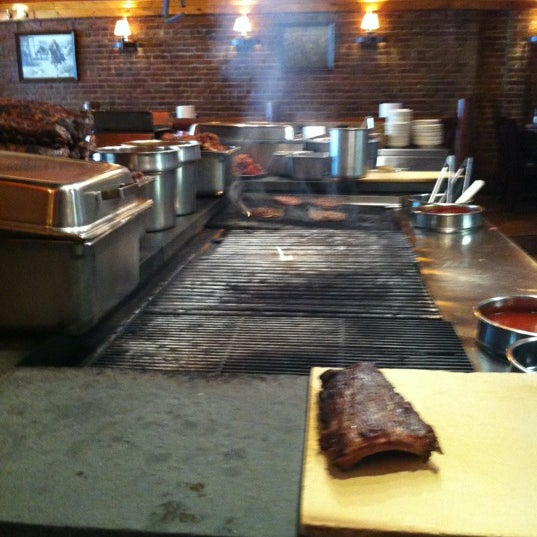 Photo taken at The Village Smokehouse by Mishy K. on 9/25/2012