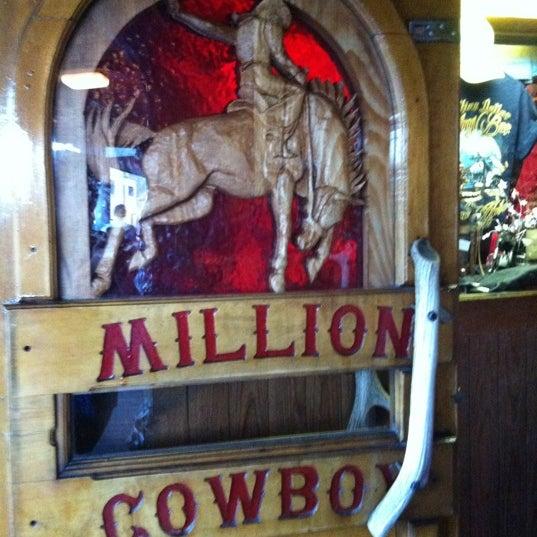 Photo taken at Million Dollar Cowboy Bar by Nicole W. on 8/5/2012