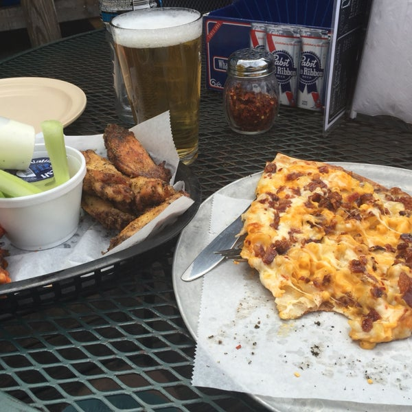 The honey bourbon and lemon pepper wings are awesome - as is all of their slices of pizza. You really can't go wrong. And $4 pitchers of High Life!