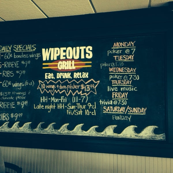 Photo taken at Wipeouts Grill by Jess W. on 3/17/2014