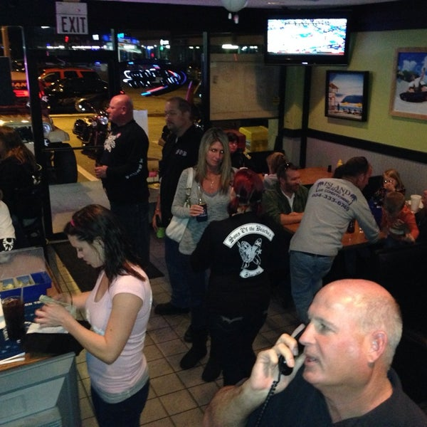 Photo taken at Wipeouts Grill by Jess W. on 4/1/2014