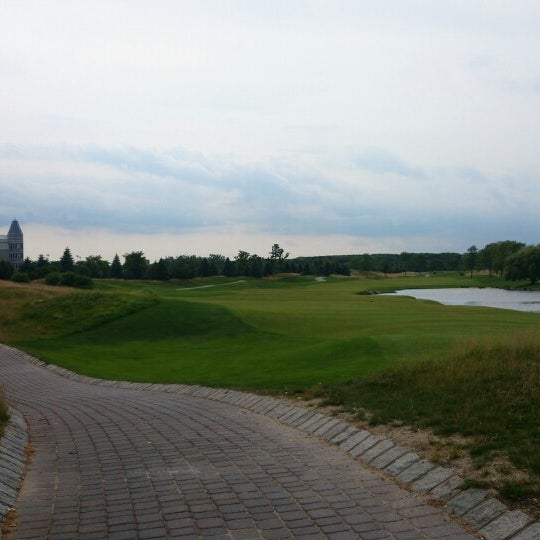 Photo taken at Liberty National Golf Course by Anastasia Z. on 6/23/2014