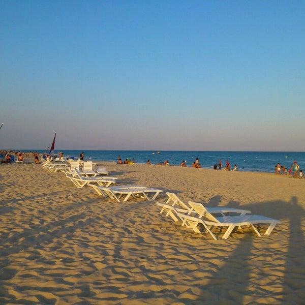 Photo taken at Praia do Barril by Manel V. on 8/15/2013