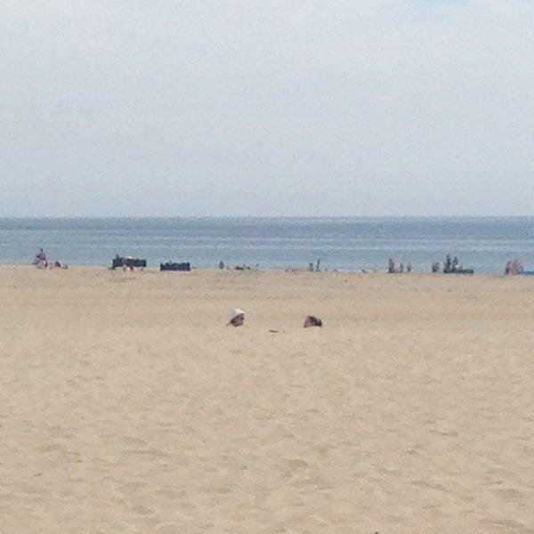 Photo taken at Praia do Titan by Sara C. on 6/4/2013