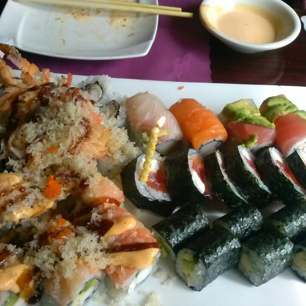 Photo taken at Sushi Cafe by Eryn S. on 10/24/2013
