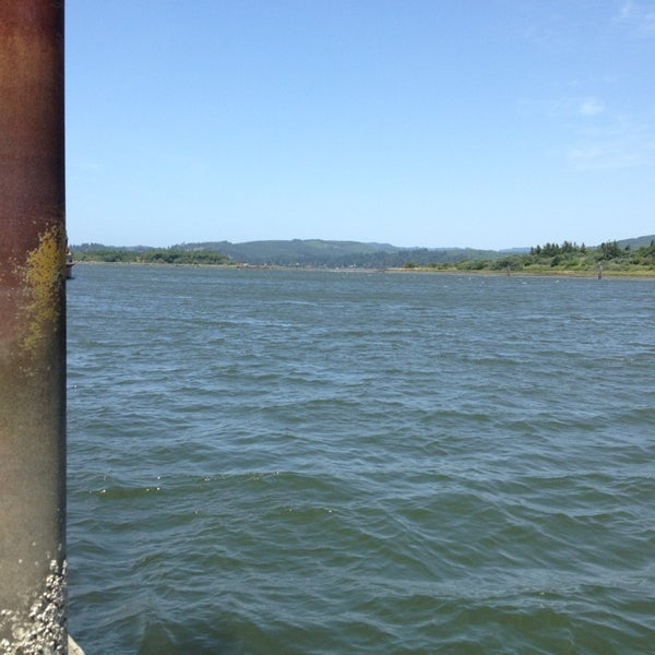 Photo taken at Coos Bay Boardwalk by Dom D. on 7/2/2013