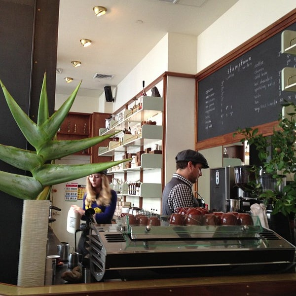 Photo taken at Stumptown Coffee Roasters by Tina Y. on 7/26/2013