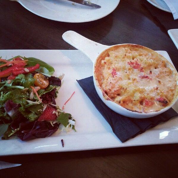 Photo taken at Glow Restaurant by Maureen W. on 9/23/2012