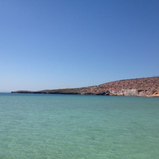 Photo taken at Playa Pichilingue by Rebeca G. on 10/2/2012
