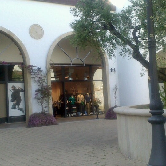 Photo taken at Fashion District - Molfetta Outlet by Caty C. on 5/9/2013