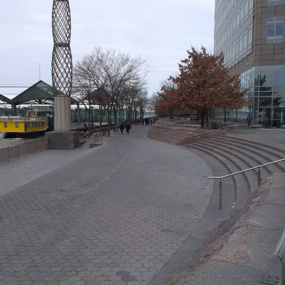 Photo taken at Battery Park City Esplanade by Katie F. on 3/3/2013