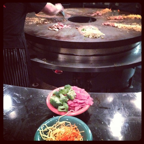Photo taken at HuHot Mongolian Grill by Brian F. on 12/5/2012