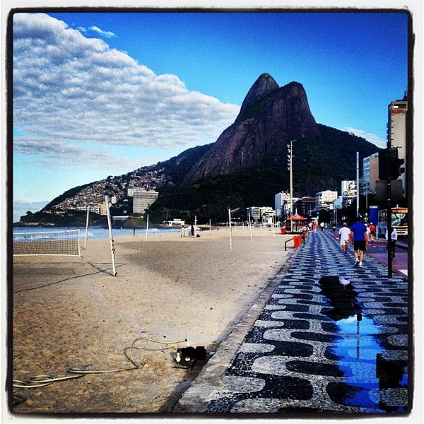 Photo taken at Ipanema Beach by FJ A. on 5/29/2013
