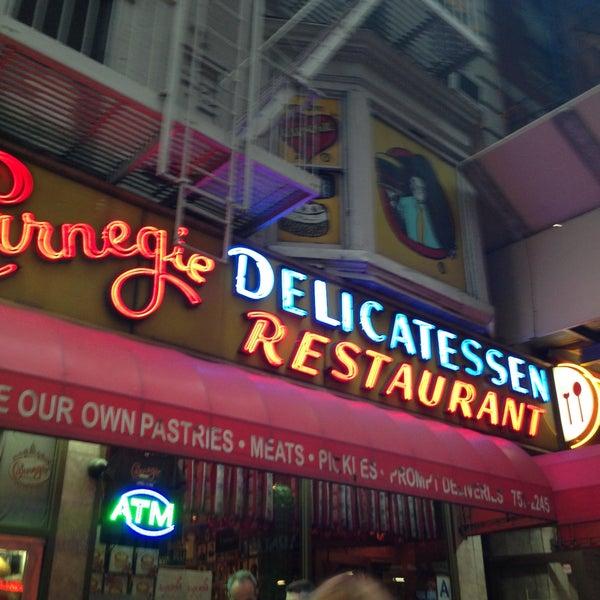 Photo taken at Carnegie Deli by Roshell W. on 5/11/2013