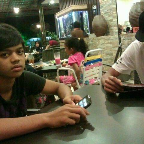 Photo taken at De Pauh Garden Restaurant & Cafe by Ras F. on 2/1/2012