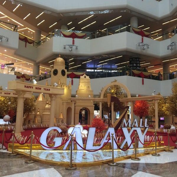 Photo taken at 银河国际购物中心 Galaxy Mall by Nelia K. on 1/26/2015