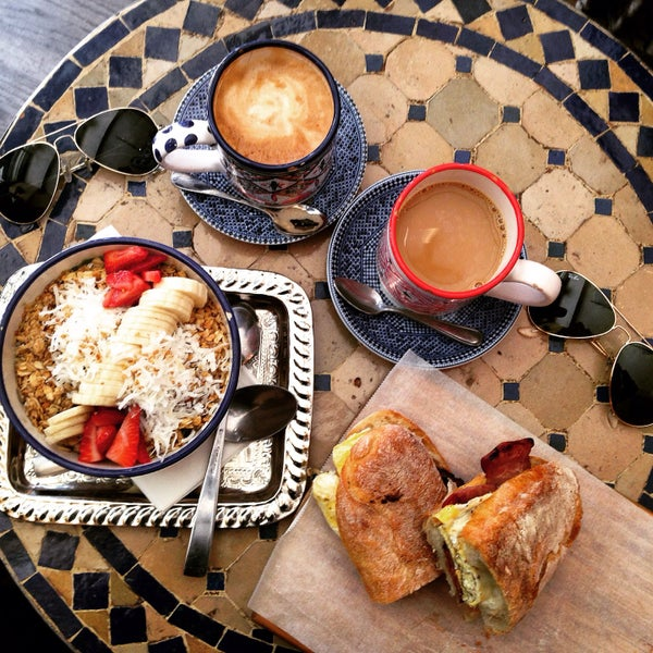 Photo taken at Pause Cafe by Chloe K. on 5/23/2015