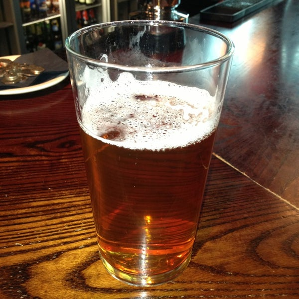 Photo taken at The Tin Goose (Pub & Kitchen) by John B. on 3/23/2013
