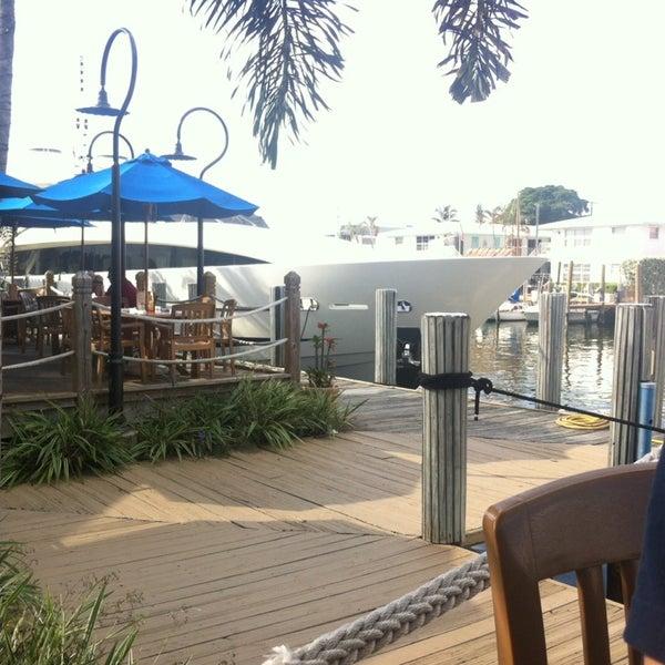 Photo taken at Bimini Boatyard Bar & Grill by Fern C. on 11/7/2014