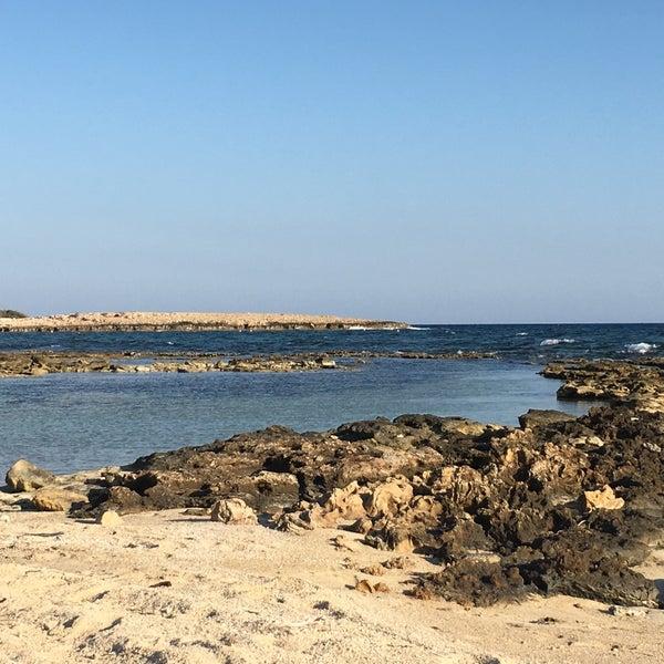 Photo taken at Makronissos beach by Adamos C. on 9/17/2016