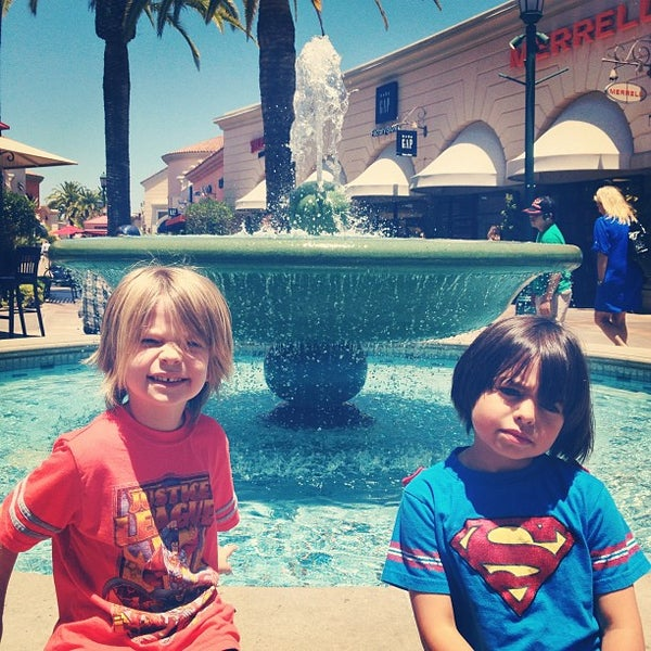 Photo taken at Carlsbad Premium Outlets by Lenka V. on 6/20/2013
