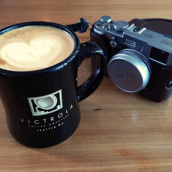 Photo taken at Victrola Cafe and Roastery by Jie L. on 6/9/2014