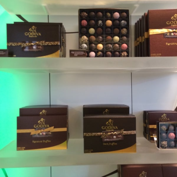 Photo taken at Godiva Chocolatier by Alex N. on 9/12/2014