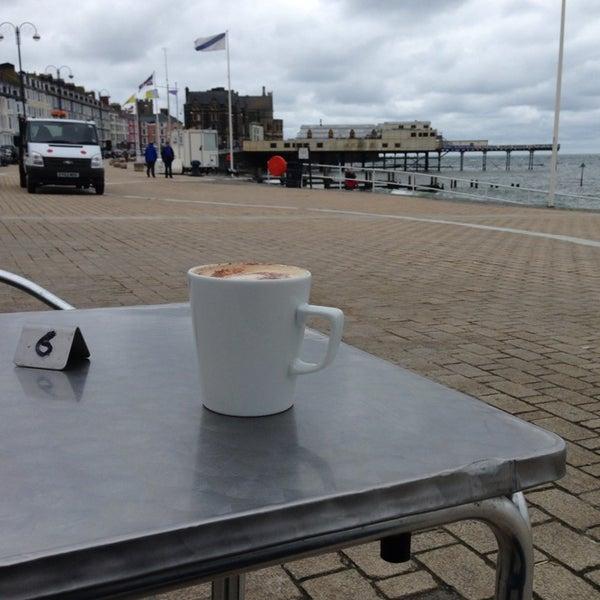 Photo taken at Aberystwyth Beach by Nicolas P. on 9/11/2013