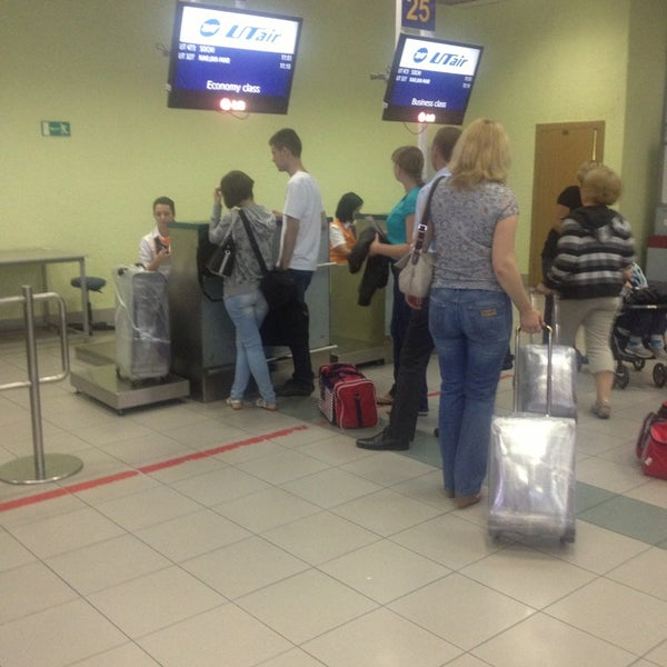 Photo taken at Check-in desk by Екатерина К. on 8/19/2013
